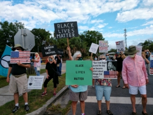 H'cola BLM sign holders show support.